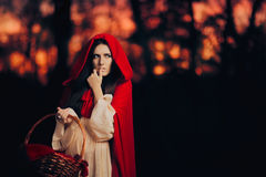 Scared Little Red Riding Hood Hiding in the Forest Royalty Free Stock Photo