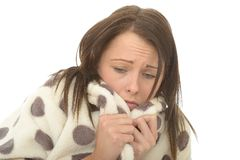 Scared Lonely Anxious Unhappy Young Attractive Woman in Spotty Dressing Gown Royalty Free Stock Image