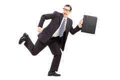 Scared male businessman running away from something Royalty Free Stock Images