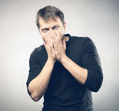 Scared man. Scared young man on grey background Stock Image