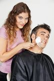 Scared Man Being Shaved By Female Barber Stock Photography