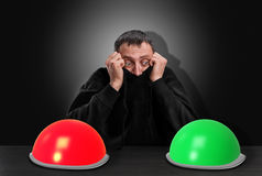 Scared man chooses right button Stock Images