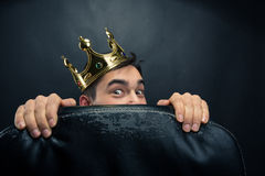 Scared man with crown Stock Photo