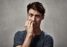 Scared man face. stock image