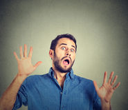 Scared man. On gray wall background Stock Image