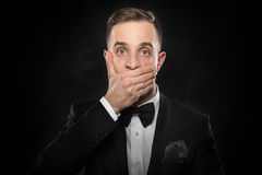Scared man hand covering mouth. Royalty Free Stock Images