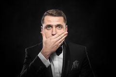 Scared man hand covering mouth. Stock Images