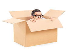 Scared man hiding in a carton box. Isolated on white background
