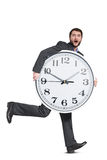 Scared man holding big clock Royalty Free Stock Photo