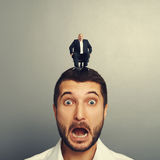 Scared man with laughing boss. Screaming scared men with laughing boss on the head Royalty Free Stock Photos