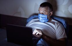 Free Scared Man Panicking Reading News On Laptop At Home Overnight Stock Photography - 180647492