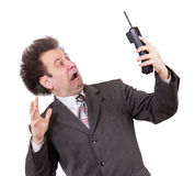 Scared man with phone Stock Images