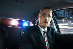 Scared man pulled over by police. Portrait Of A Young Scared Man Pulled Over By Police Royalty Free Stock Photography