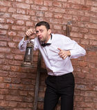 Scared man searching with an oil lamp Stock Photography