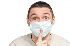 Scared man silence sign  in protective mask Royalty Free Stock Photography