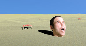 Scared man stuck in sand Royalty Free Stock Photography