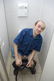 Scared man in toilet Stock Photos