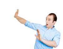 Scared man trying to protect himself Royalty Free Stock Images