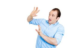Scared man trying to protect himself Royalty Free Stock Photography