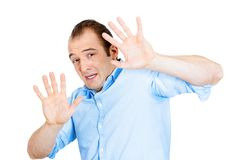 Scared man trying to protect himself Stock Images