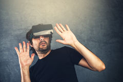 Scared man with virtual reality goggles Stock Photography