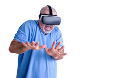 Scared man wearing virtual reality glasses Stock Images