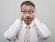 Scared Manager. Man holds his hands to his head stock photography