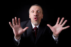 Scared mature businessman Stock Photography