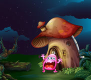 A scared monster near the mushroom house Royalty Free Stock Photos