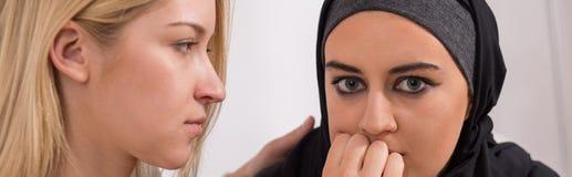 Scared muslim woman Stock Photo