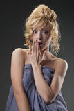 Scared naked woman Stock Image
