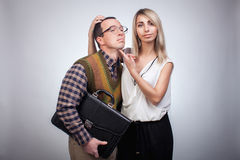 Scared nerd with girl Stock Image