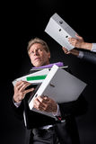 Scared overworked mature businessman holding pile of folders Royalty Free Stock Images