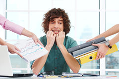 Scared overworked young businessman with hands Stock Image