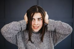 Scared panicked woman covering ears with hands stock images