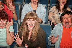 Scared People In Audience. Group of screaming people at the movies Stock Photo