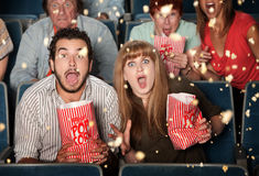 Scared People Tossing Popcorn Royalty Free Stock Image