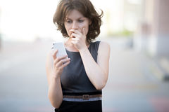 Scared by phone call Royalty Free Stock Photos