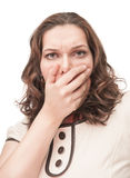 Scared plus size woman closed mouth by hand Royalty Free Stock Photography