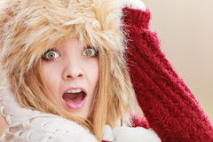 Scared pretty fashion woman in fur winter hat Royalty Free Stock Photography
