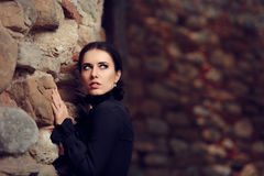 Scared Princess Near Castle Wall. Portrait of gothic queen in scary dangerous situation Stock Images