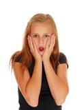 Scared que mira a la chica joven Fotografía de archivo libre de regalías