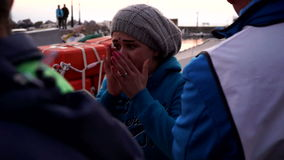 Scared refugee mother. Refugees have just arrived to the coast of Lesvos, Greece.