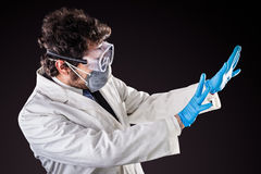 Scared researcher in labcoat Royalty Free Stock Images