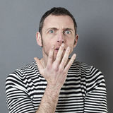 Scared 40s man questioning something Royalty Free Stock Photo