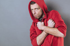 Scared 40s man standing with fists crossed on chest Stock Images