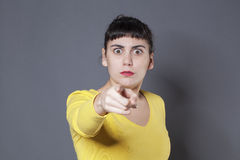 Scared 20s woman denouncing a problem Royalty Free Stock Photography