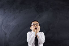 Scared schoolboy biting his nails Royalty Free Stock Photo