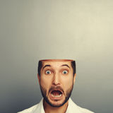 Scared screaming man with open head Royalty Free Stock Photography