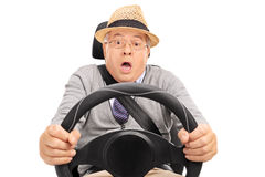 Scared senior driving and pressing the brake Royalty Free Stock Photos